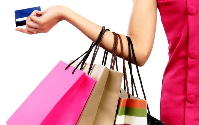 woman-with-credit-card-and-shopping-bags